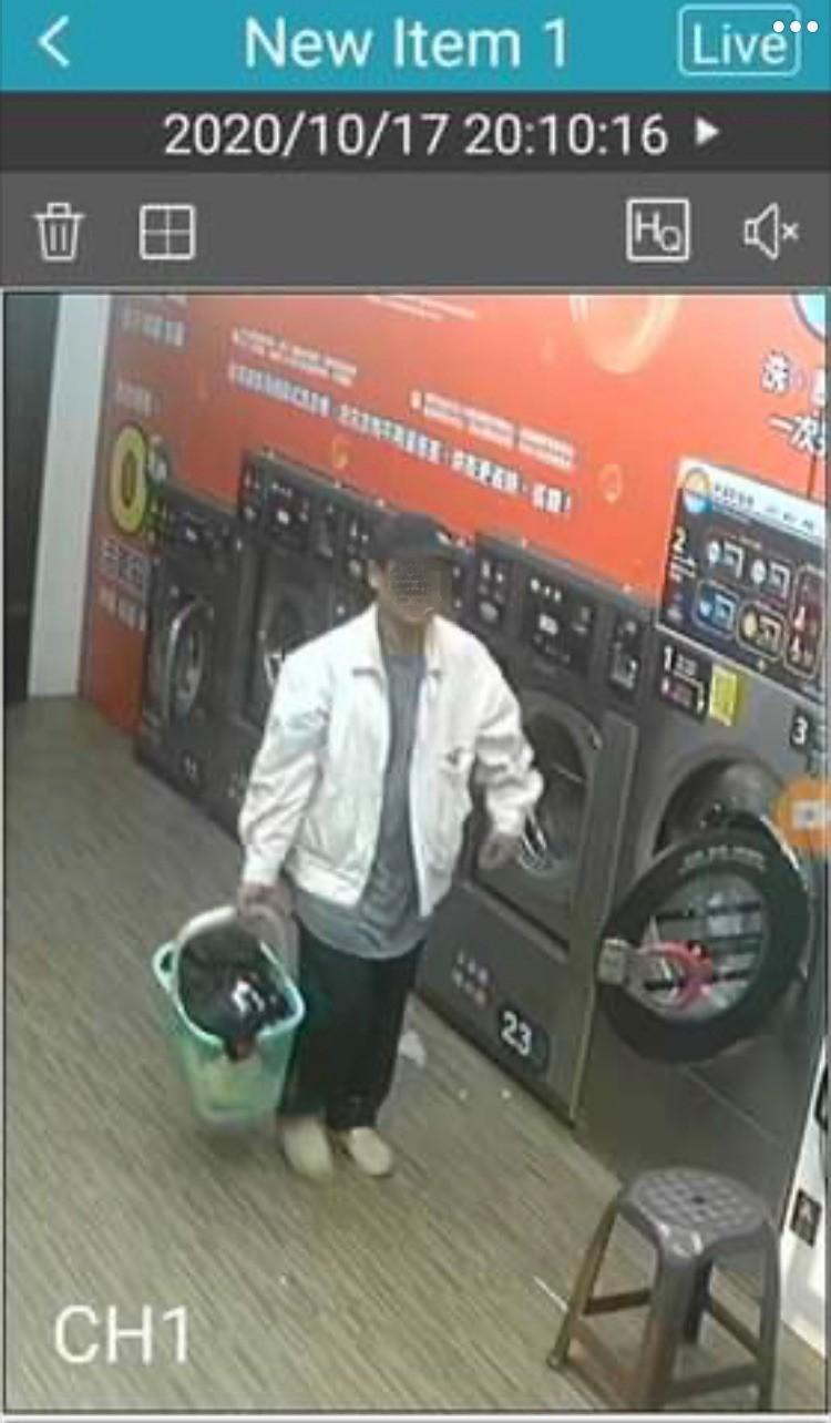 涉嫌在自助洗衣店拿走林男清洗的床單被套的不明男子。(記者陳恩惠翻攝)