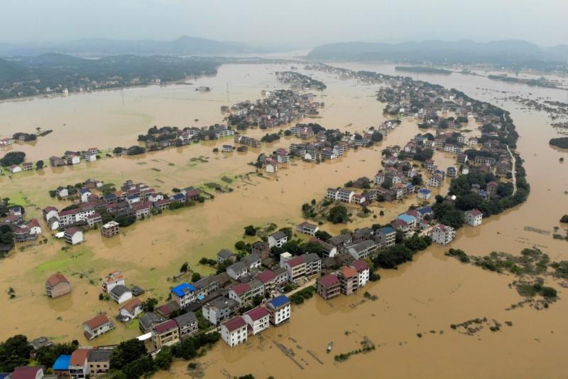 湘江東側支流「洣水」流入市鎮,官媒對災情毫無報導。(路透)