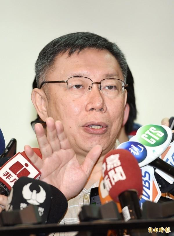 柯文哲今天回應:打高空沒有用,他也很想知道蔡總統的台灣價值是什麼。(記者方賓照攝)