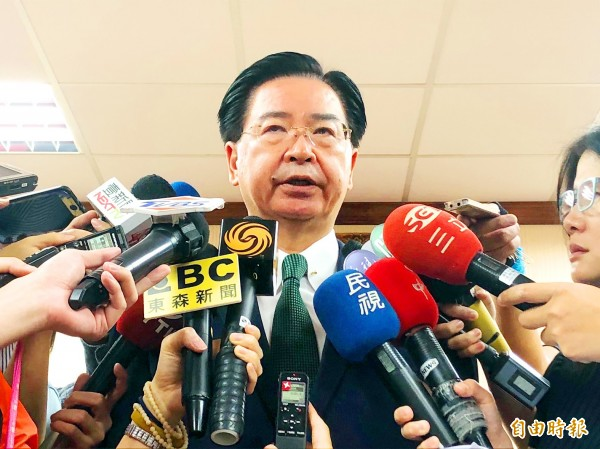 Minister of Foreign Affairs Joseph Wu yesterday talks to reporters in Taipei ahead of a meeting of the legislature's Foreign Affairs and National Defense Committee. Photo: Lu Yi-hsuen, Taipei Times