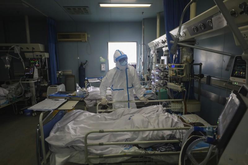 湖北省14日通報,13日新增確診4823例,死亡增加116例。(美聯社資料照)