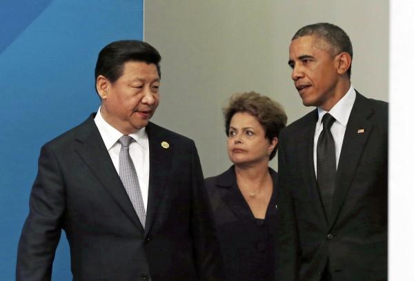 歐巴馬(右)數度表示支持香港佔中,預估將讓習近平(左)有所回應。(路透)