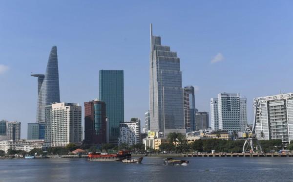 中國近期開始對一二線城市加強房地產限購政策,迫使中國炒房團轉向國外投資,迅速炒熱越南、泰國等價格低廉的房地產市場。圖為胡志明市。(法新社資料照)