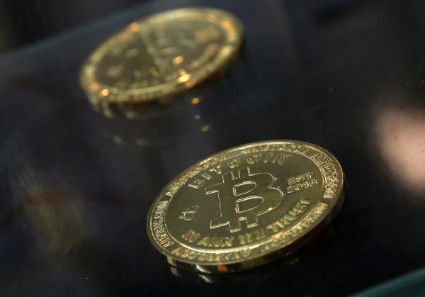 最近炒作起來的比特幣,讓部分投資客趨之若鶩。(美聯社)