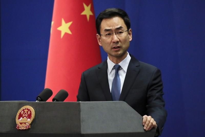 中國外交部發言人耿爽回擊美國副總統彭斯和國務卿龐皮歐「與邪教分子同流合汙」。(資料照,美聯社)