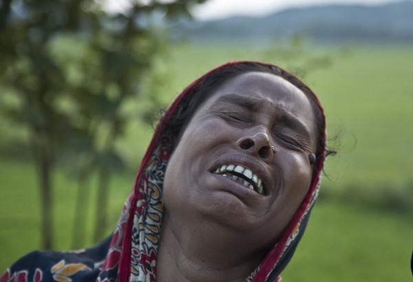 阿薩姆邦當局為打擊盜獵,下令拆除卡濟蘭加國家公園附近的3個村落,當地居民不滿房屋遭拆。(美聯社)