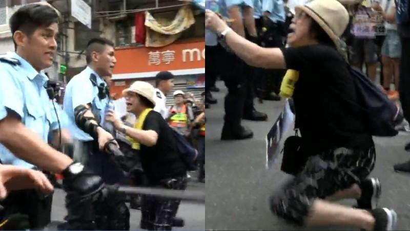 一名香港媽媽雙膝跪地,懇求員警離開,但員警只是繞過她繼續往前走;這名不死心的媽媽則是再度繞到警察前面,伸開雙臂不斷哀求,但下秒警察在長官一聲令下立刻將她推開,隨後其中一名神色凶狠的警察(圖左1),更是手持警棍,朝著道路上的民眾一陣亂打。(擷取自「香港電台視像新聞 RTHK VNEWS」直播)