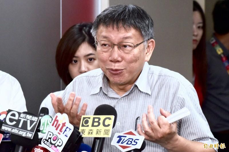 台北市長柯文哲今日受訪時被問到對此事的看法,他稱整起事件是「擦槍走火」。(記者塗建榮攝)