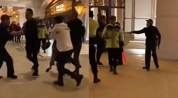 中國男子對澳門警方嗆聲,被員警開槍嚇阻。(圖擷取自微博)