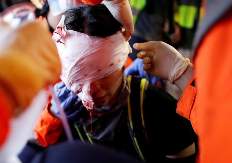 外媒《紐約時報》今日以「港警臥底是如何血腥鎮壓示威群眾」為題,進行刊文。(路透)