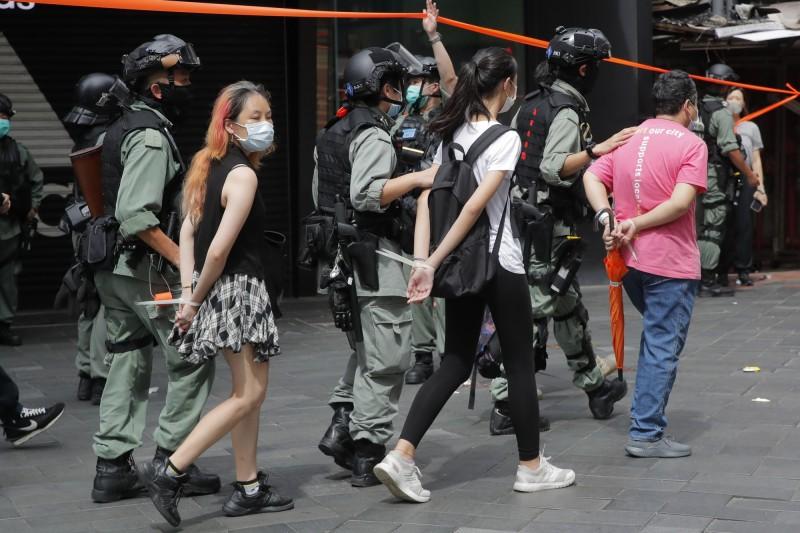 時代力量前立委黃國昌批,中國把「反對中共政權」、「支持香港民主」視為「危害全人類」的犯罪,令人嘆為觀止。(美聯社)