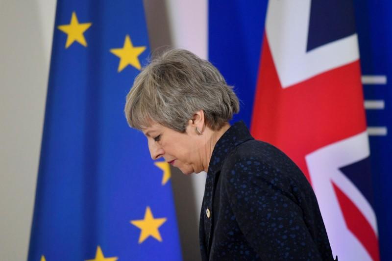 脫歐陷入僵局,黨內同志逼宮,面臨內憂外患的英國首相梅伊,傳出最快明宣布辭職。(路透)