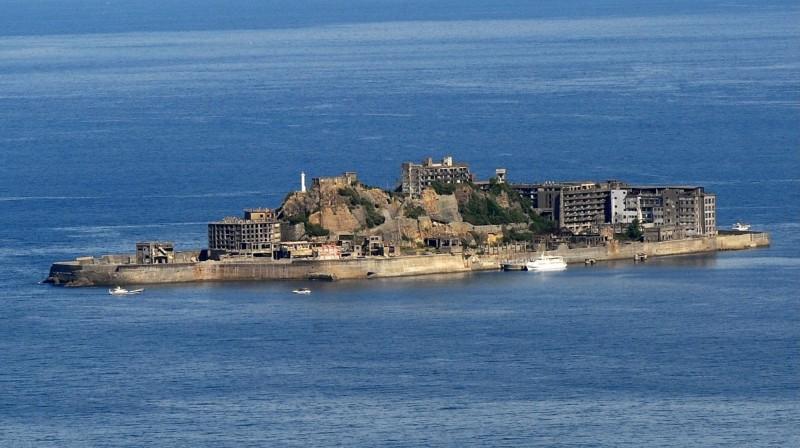 日本長崎「軍艦島」端島,已在本月10日起重新開放登島。(法新社)