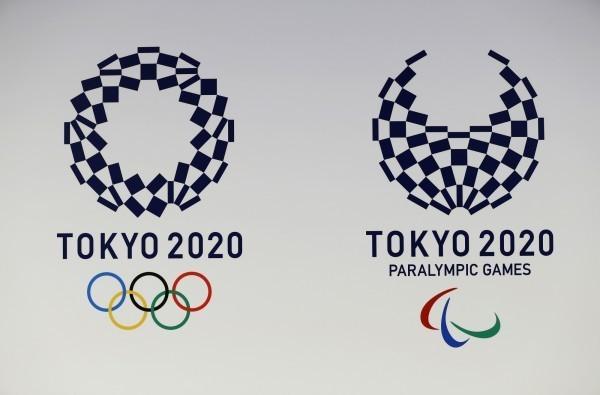 東京奧運會及殘奧會會徽「組市松紋」圖,被刻在偽造的紀念章上營利,嫌犯已遭日本警方逮捕。(美聯社)