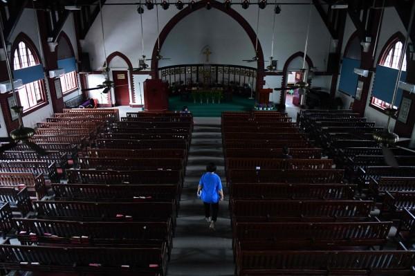 中國打壓宗教自由情形嚴重,傳出已有多個地區禁止師生、醫護人員信教。(法新社)