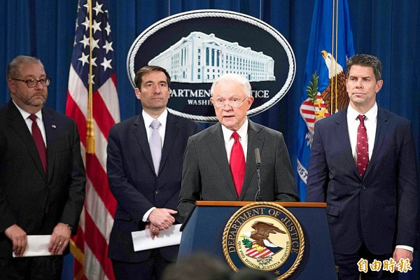 US Attorney General Jeff Sessions, center, announces the creation of a new initiative to crack down on Chinese intelligence officials pilfering intellectual property from U.S. corporations through hacking and espionage during a press conference at the Justice Department in Washington on Thursday. Sessions announced charges against Chinese and Taiwan companies for theft of business secrets from US chip giant Micron. Photo: AFP