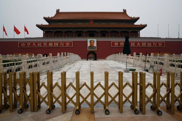 中國本月舉辦改革開放40週年大會,但場內部分與會人士神情凝重。(彭博)