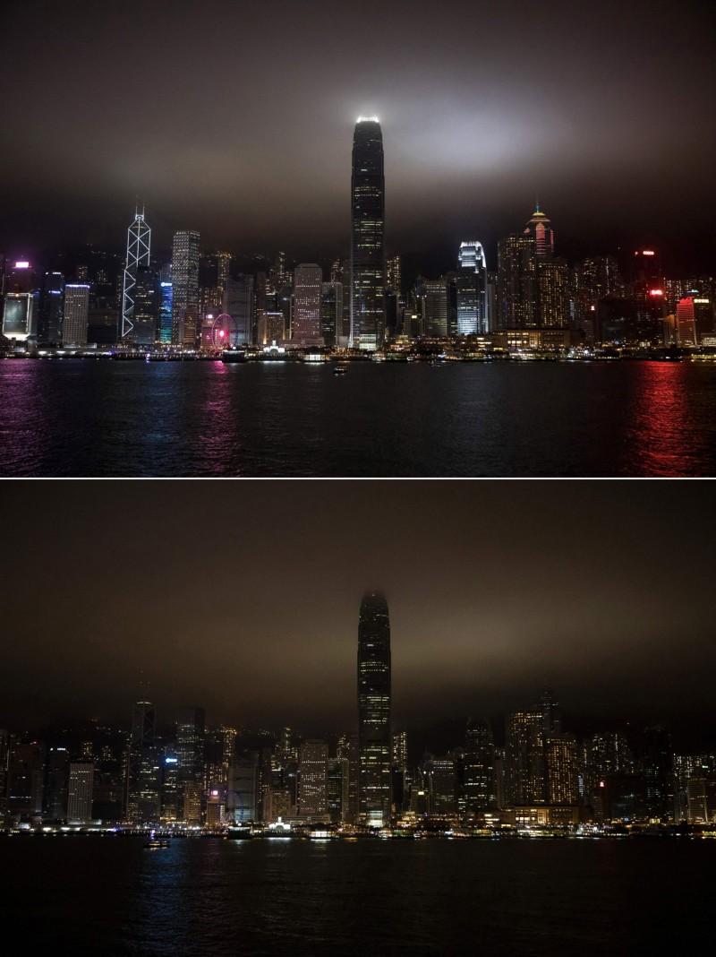香港著名地景維多利亞港(Victoria Harbour)響應「地球一小時」活動。(法新社)