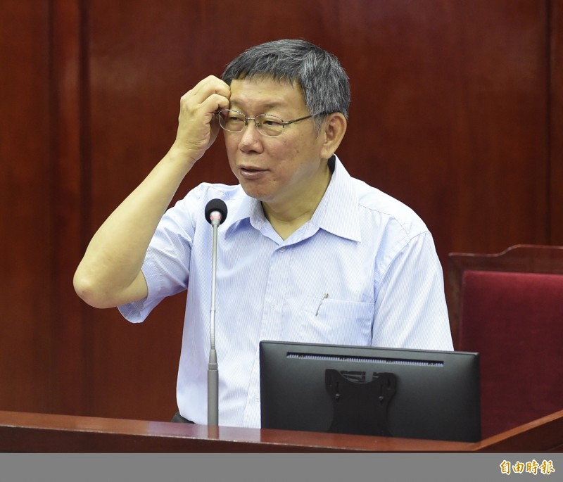 台北市長柯文哲20日赴台北市議會專案報告,並接受議員質詢。(記者簡榮豐攝)