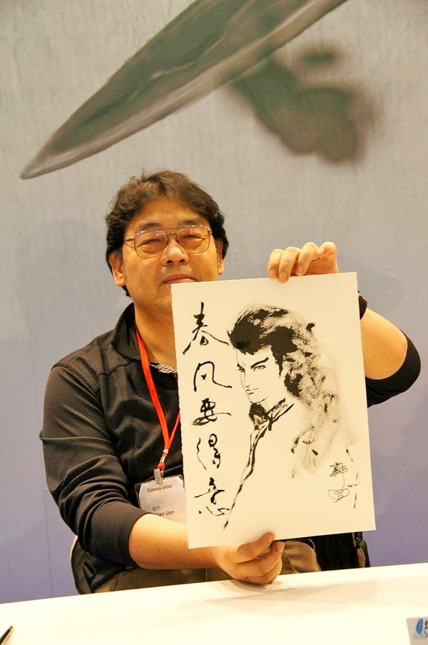 Graphic artist Chen Uen holds one of his works at the Angouleme International Comics Festival in France in 2012. Photo courtesy of Dala Publishing Co