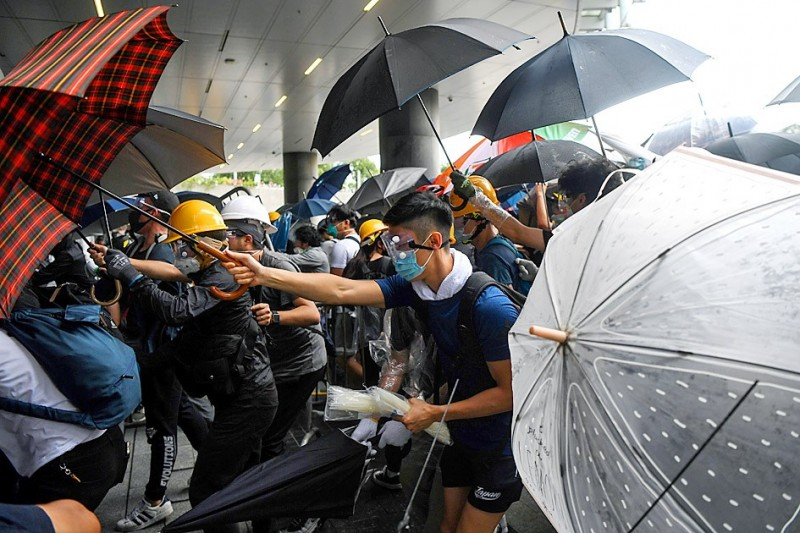 Protesters clash with police during a demonstration outside the Hong Kong Legislative Council yesterday.  Photo: AFP
