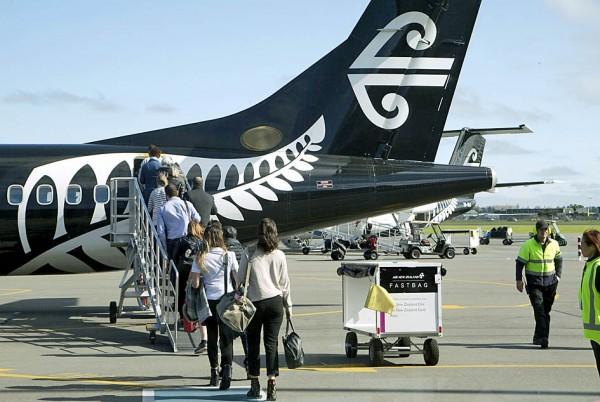 Passengers board an Air New Zealand flight at Christchurch International Airport on Sept. 20, 2017. Photo: AP