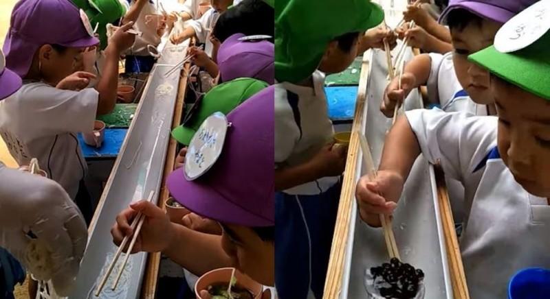 日本孩童吃完特色美食「流水麵」後,嘗試挑戰用筷子夾「流水珍珠」。(吳姓民眾提供)