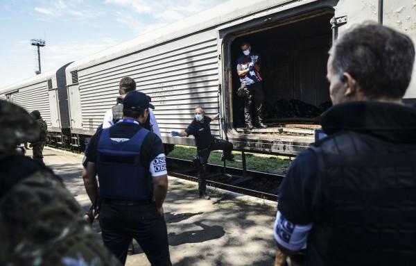 荷蘭鑑識專家表示,希望能將運屍火車移往別處方便進行驗屍。(法新社)