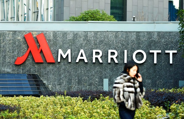 This photo taken on Friday shows a woman walking past Marriott signage in Hangzhou in China`s Zhejiang province. Authorities in China have shut down Marriott`s local website for a week after the US hotel giant listed Chinese-claimed regions such as Taiwan and Hong Kong as separate countries. Photo: AFP