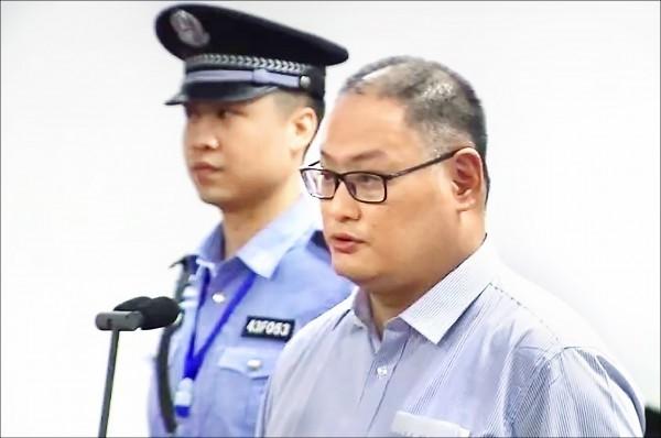 為爭取國際社會支持無故遭中國判刑入獄的我國非政府組織工作者李明哲(圖右)。(法新社檔案照)