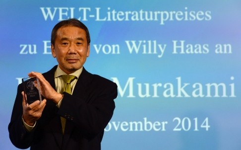 日本作家村上春樹7日赴德國柏林領文學獎,鼓勵香港「佔中」的年輕人,打造一個沒有高牆的世界。(法新社)