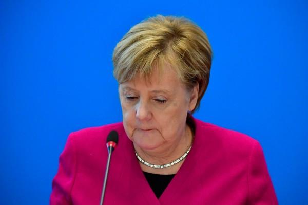 梅克爾領導的執政聯盟在本月的德國地方選舉接連失利,在黨內與相關政黨的壓力下,據傳她將不再競選基督教民主聯盟的主席。(法新社)