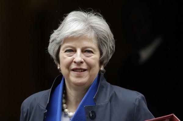 時任英國內政大臣、今英國首相梅伊(見圖)曾要求負責測驗的「ETS」對考試語音檔進行分析比對,檢查考生是否有請槍手代考。(美聯社)