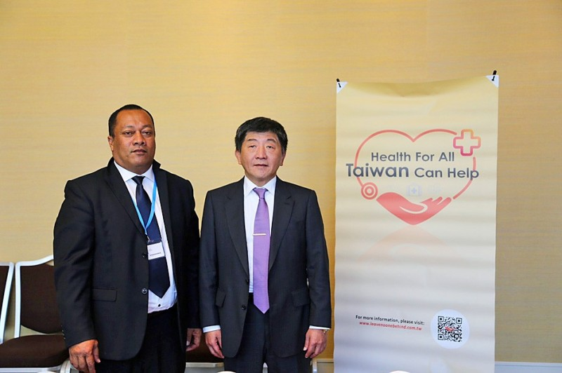"Solomon Islands Minister of Health and Medical Services Dickson Mua Panakitasi, left, and Minister of Health and Welfare Chen Shih-chung stand next to a banner that reads: ""Health for all: Taiwan can help"" at a bilateral forum near the venue of the World Health Assembly in Geneva, Switzerland, on Tuesday. Photo courtesy of the Ministry of Health and Welfare"