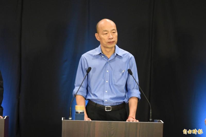 國民黨總統參選人韓國瑜25日在政見會上,談到如何捍衛國家安全時,他以水、浴缸、塞子來比喻美中台三方關係。(記者張忠義攝)
