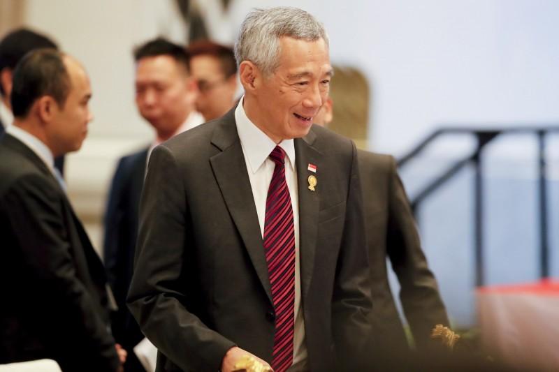 新加坡總理李顯龍23日接受媒體專訪時表示,中國和美國應該在「最高層級」建立信任。(歐新社)