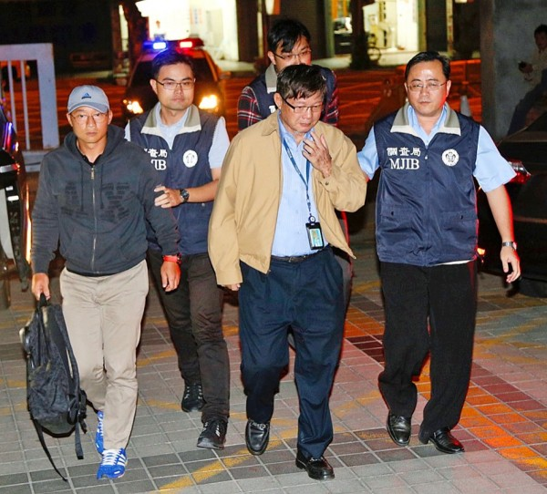 Chen Wei-chih, left, and his father, Ching Fu Shipbuilding Co president Chen Ching-nan, second right, are escorted in Taipei by officials from the Ministry of Justice's Investigation Bureau in an undated photograph. Photo: CNA