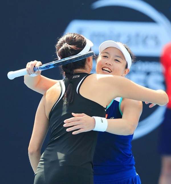 Chan Hao-Ching, left, and Latisha Chan of Taiwan embrace after defeating Kirsten Flipkens of Belgium and Johanna Larsson of Sweden in their Hobart International women's doubles finals at the Domain Tennis Centre in Hobart, Australia, yesterday. Photo: EPA-EFE