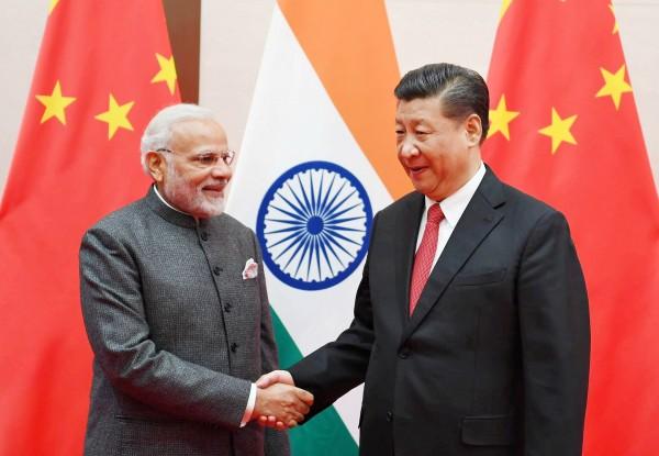印度總理莫迪4月和中國領導人習近平會晤,但執政黨印度人民黨(BJP)的幹部培訓手冊,仍將中國視為印度的主要威脅。(路透)