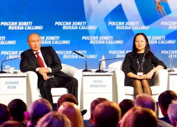 """Russian President Vladimir Putin, left, and Huawei Technologies Co chief financial officer Meng Wanzhou attend a session of the VTB Capital Investment Forum """"Russia Calling!"""" in Moscow, Russia, on Oct. 2, 2014. Photo: Reuters"""