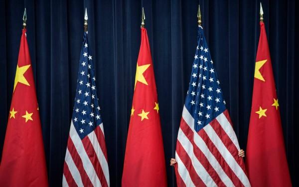 美中貿易戰升溫,外媒引述消息人士指出,這場貿易戰已導致中共內部出現矛盾。(法新社)