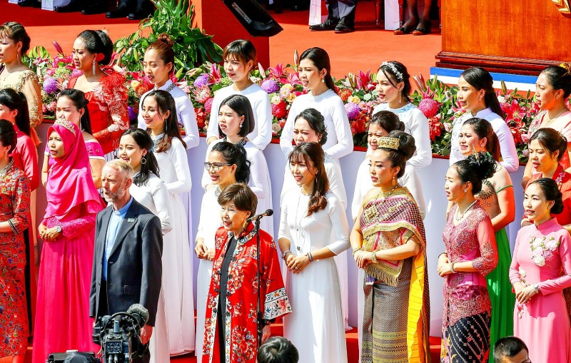 Father Edmund Ryden, left front, and a 30-member chorus of women from Southeast Asiannations sang the national anthem at yesterday's Double Ten Day National Ceremony in Taipei. Photo: Maurice Tsai, Bloomberg News