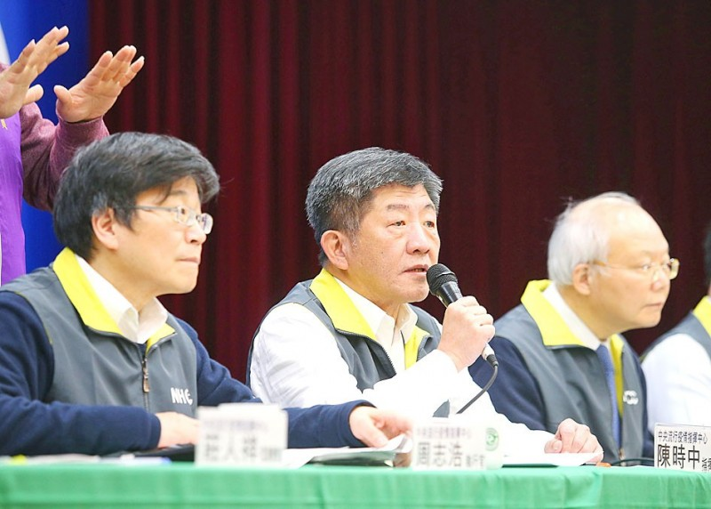 Minister of Health and Welfare Chen Shih-chung, center, speaks at a news conference held by the Central Epidemic Command Center in Taipei yesterday. Photo: CNA