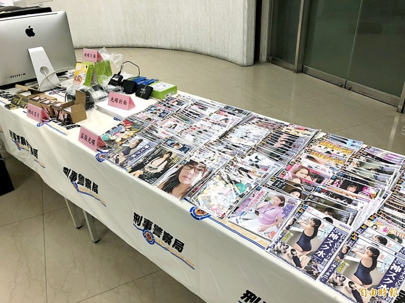 Computer equipment and copyrighted Japanese adult video materials that were seized in a police raid are displayed at the Criminal Investigation Bureau in Taipei yesterday. Photo: Chiu Chun-fu, Taipei Times