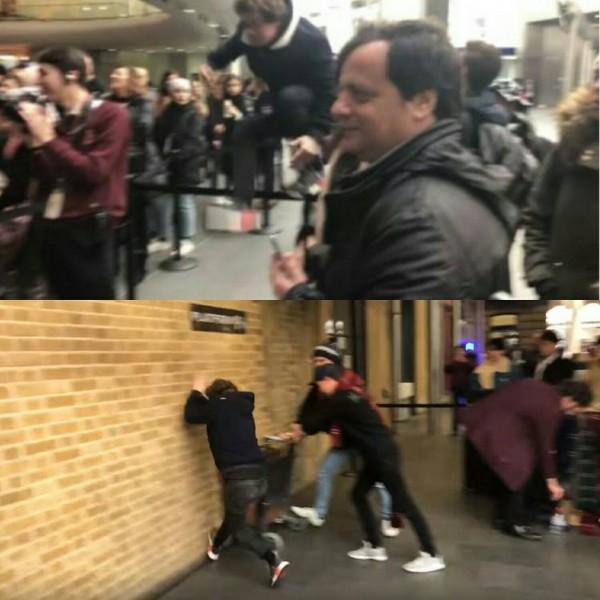 男子忽然衝出人群,撞向「通往魔法世界」的入口。(圖擷取自youtube)