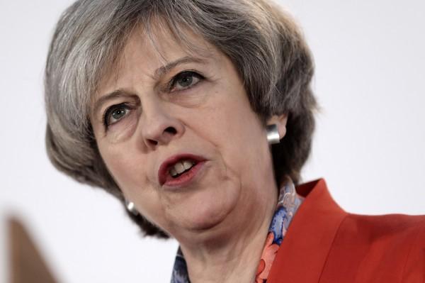 英國首相梅伊將於29日向歐盟啟動《里斯本條約》第50條,正式展開英國脫歐談判。(彭博)