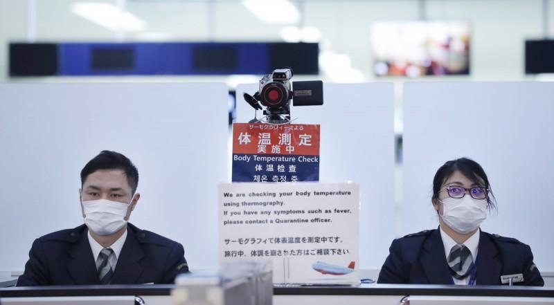 中國「武漢肺炎」疫情持續延燒,日本的確診病例為住在神奈川縣的30多歲中國籍男性,該名男子在6日入境日本前就已發燒,但因事先服用退燒藥,並未在入境時被發現異狀。(法新社)