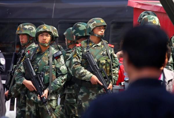 中國在新疆推行反對清真產品的運動,阻止伊斯蘭教滲透進民眾的日常生活。(路透)