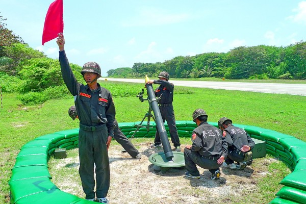 Coast Guard Administration officers perform a drill on Itu Aba Island (Taiping Island) in the Spratly Islands (Nansha Islands) on Aug 31. Photo: Lo Tien-pin, Taipei Times