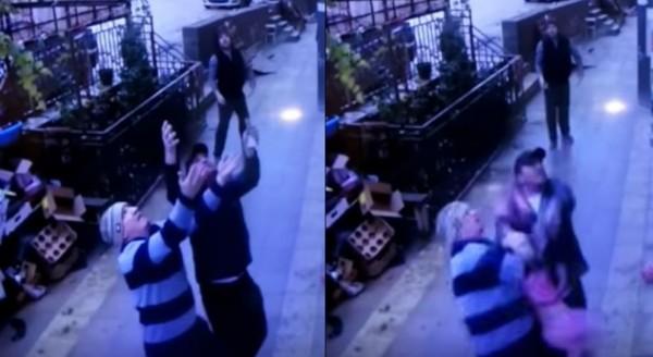 5歲女童自5樓墜下,2名路人成功救援。(圖擷取自影片)